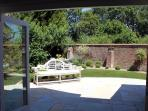 Step out from the sitting room into the walled rear garden