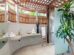 1st en-suite bathroom with shower and single wash basin