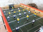 2 table football games - one in each house