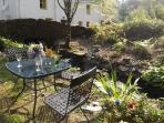 A burn borders the patio garden and is a lovely place to sit and enjoy the sound of water