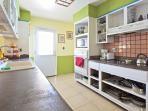 Kitchen with large side by side fridge, range, microwave, blender, oven, toaster, coffee maker!
