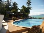 Stunning communal pool with private bar and plenty of sun loungers