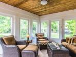 Screened Porch Opens to Patio Dining and Grilling Area