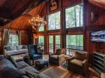 Great Room with a gas fireplace overlooking Lake