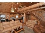 Living room wood floors, Solid pole beams, Walls & ceiling wood also
