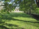 Extensive lawns beyond barns