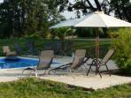 deck-chairs near swimmingpool domaine Mounoy