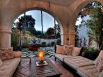 Enjoy a quiet moment in this enchanting shaded patio off master bedroom