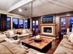 Expansive living room has television, fireplace, and room for everyone