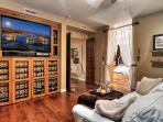 Master bedroom has HD television and private bath through curtained doorway