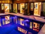 Elegant Palm View Villa lit at evening time