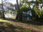 The cottage in autumn with smoking chimney