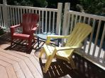 Large comfortable deck with lots of chairs