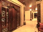 Marble Flooring And Intricatetly Carved Bedroom Doors