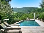 Casa Ospicchio: pool area with sun loungers