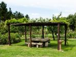 The table in the gazebo is made of a single natural stone coming from the Dolomite Mountains in Tren