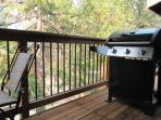 Propane barbecue on the deck with seating.
