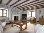 Beautiful lounge with dual aspect windows and lots of books, DVDs etc for all the family