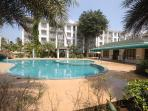 Akar Excelsior Court yard gardens grounds with swimming pool, kids play area, large law area
