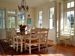 Spacious dining room with plenty of seating and natural light