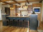 Gourmet Kitchen with High End Appliances and Counter Top Seating Area