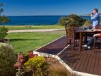 Panoramic sea views from the deck and living area.