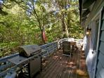 Deck on main level with BBQ and patio furniture