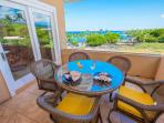 The outdoor lanai offers breathtaking views of Kahaluu Beach and the Kona coast.