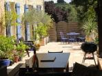 The large south facing terrace,a great entertaining area with BBQ and outdoor kitchen.