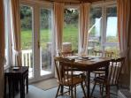 dining area where you can sit and watch red squirrels on the feeders