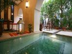 pool next to the blooming courtyard