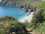 Walk the costal path to Lantic Bay - It's simply stunning.