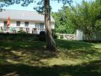 Large fenced back yard with 2 sheds