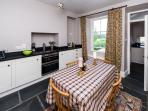 Kitchen / dining area with slate flooring and under-floor heating and granite worktops throughout
