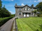 Traditional lakeland slate semi-detached cottage with lovely peaceful south-facing garden