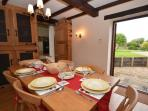 Dining area with patio doors out to enclosed garden