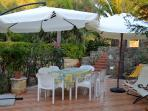 Relaxing patio with garden. Pools and beaches inside the residence, within 300 metres from villa.