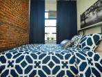 Bedroom 2 Cozy! Air conditioner unit in top of window