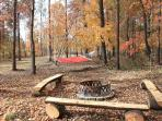 Firepit area and hammock behind cabin