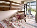 Twin bedroom with lake views and direct access to deck