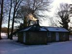 Winter view of the cottage in snow
