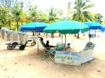 Rent beach chairs and umbrellas at El Balneario Monserrate. Enjoy coconut water, pina coloadas, food