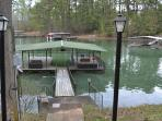 covered dock with 1 slip, private cove with no wake