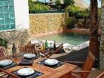 Al fresco dinning area overlooking the pool