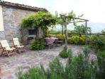 The garden with pergola for shade. There is plenty of dining furniture and sun loungers.