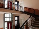 there is a lift and also a beautiful staircase leading to the apartment