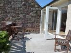 French doors onto patio area with seating and bbq