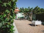 Large yard with lots of greenery. Your children can play while you enjoy a coffee or a glass of wine