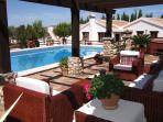 Relax by the pool and enjoy the mountain views