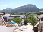 Views from the roof terrace, showing the main pool and mountains